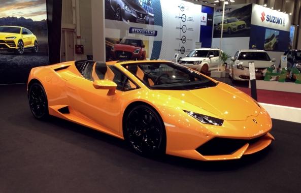 Gucci bikini, yellow Lamborghini.